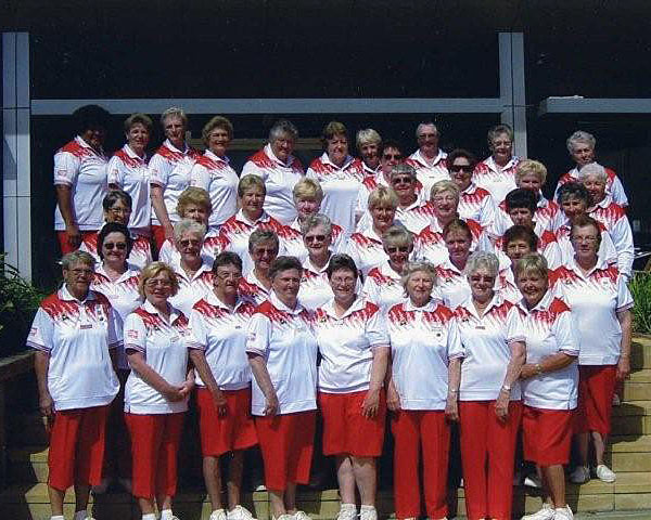 St.Georges Basin Country Club wearing Domino Lawn Bowls Wear Red as supplied by Illawarra Lawn Bowls Shop. domino - the best bowls wear supplier